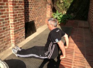 Garage-gym-dispaying-workout-without-equipment