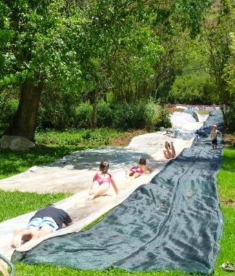 Adults and children having fun on waterslide