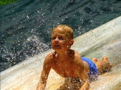 Young boy having fun on waterslide